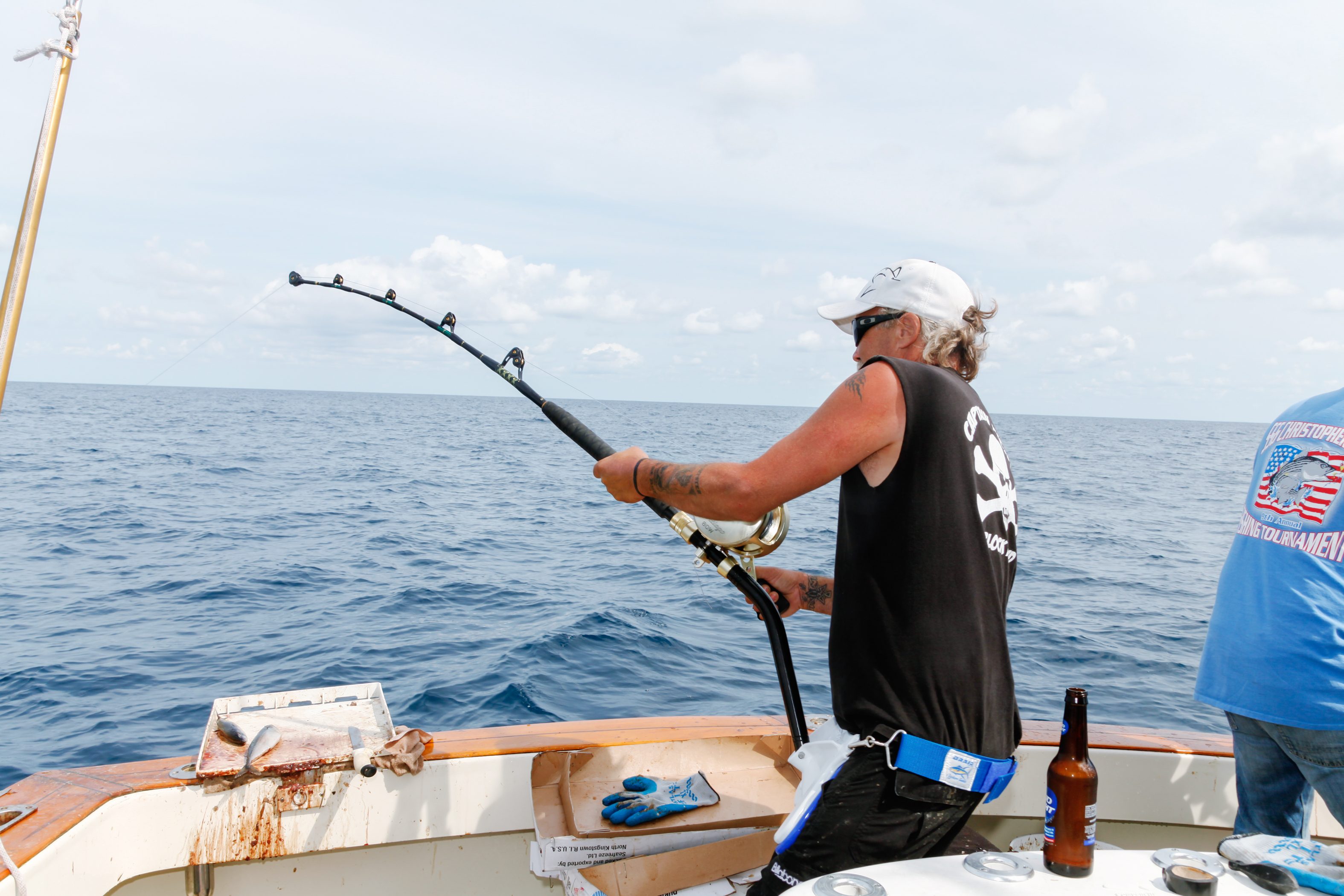 A crew member reeling in the shark using a waist harness. Though it didn't take too long to bring the shark in, the shark put up a fight.