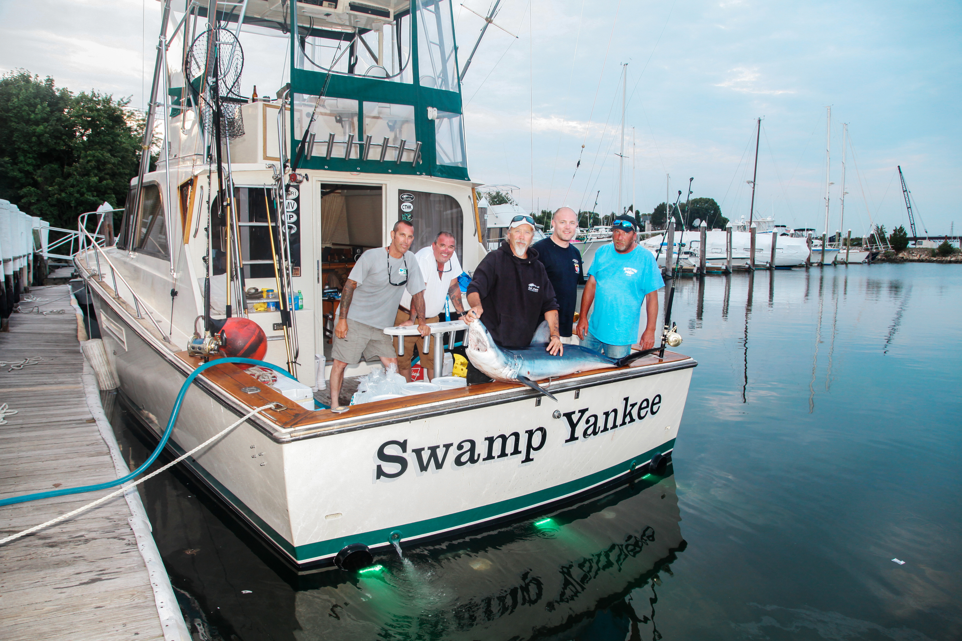 The whole crew of the Swamp Yankee with their catch.
